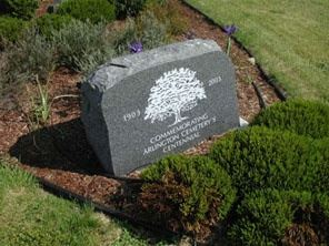 A grave stone in the ground.